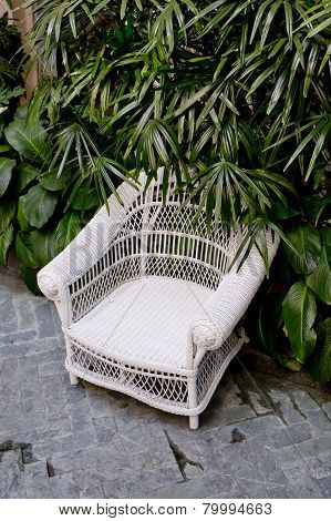 Rattan Chair With Green Trees At Outdoor