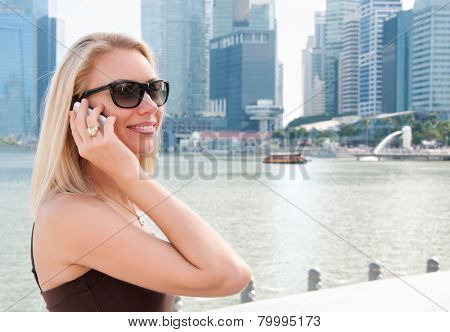 Beautiful young woman talking on the phone in Singapore