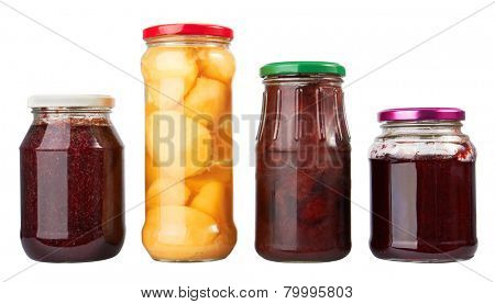 Jars with canned fruits isolated on white