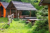 pic of gazebo  - Wooden tables and benches in the gazebo at the park - JPG