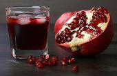 picture of pomegranate  - pomegranate juice with ice and red pomegranate fruit - JPG