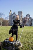 picture of pale skin  - Witch with pale skin with broom near ruins - JPG