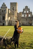 pic of pale skin  - Witch with pale skin embraces pumpkin both hands - JPG