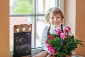 pic of bunch roses  - Happy lovely smiling little kid boy with blooming pink roses in bunch and blackboard congratulating his mum for mother - JPG