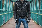picture of anarchists  - Punk guy with cigarette posing in the city streets - JPG
