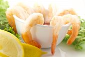 stock photo of romaine lettuce  - fresh shrimp cocktail with sauce lemon wedges and garnished with crispy romaine lettuce - JPG