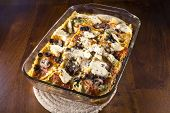 picture of artichoke hearts  - Homade vegetarian lasagna casserole topped with sliced mushrooms olives and artichoke hearts - JPG