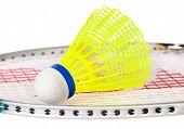 foto of shuttlecock  - Shuttlecock lying on the badminton racket isolated on white background - JPG