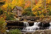 foto of water-mill  - The beautiful and picturesque Glade Creek Grist Mill amidst the amazing colors of autumn at Babcock State Park in West Virginia - JPG