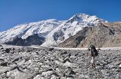 picture of shan  - Hiker with backpack on glacier below snow - JPG