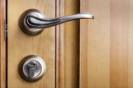 pic of door-handle  - Modern style door handle on natural wooden door - JPG