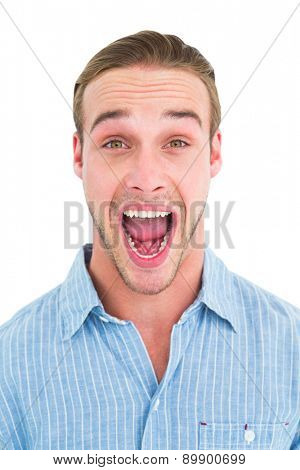 Handsome man screaming out loud on white background