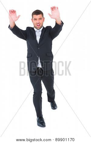 Businessman with his hands up on white background