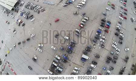 Aerial view of the big parking with car in city.