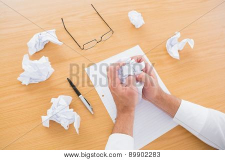 Businessman running out of ideas in his office