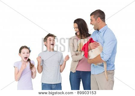 Happy mother and father gifting puppy to children over white background