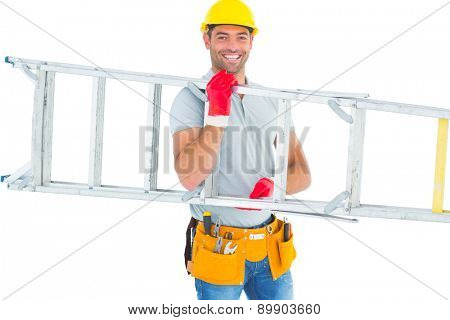 Portrait of smiling male workman carrying ladder on white background