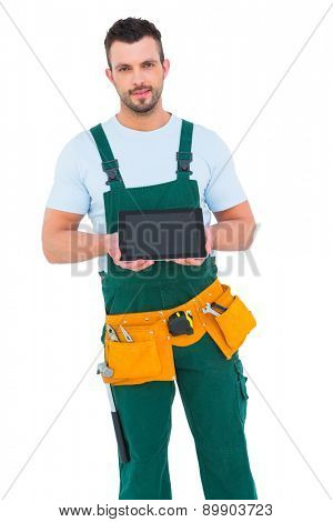 Construction worker holding tablet pc on white background