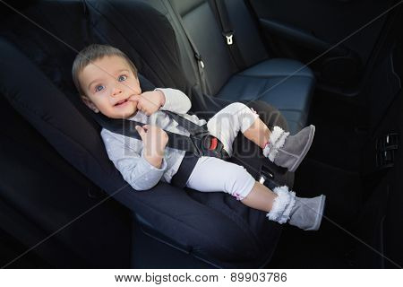 Cute baby in a car seat in the car