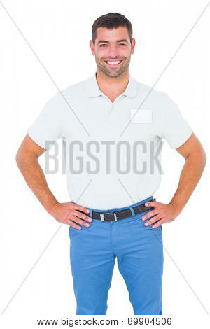 Portrait of smiling male technician standing hands on hip on white background