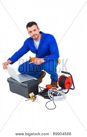 Electrician using laptop on white background