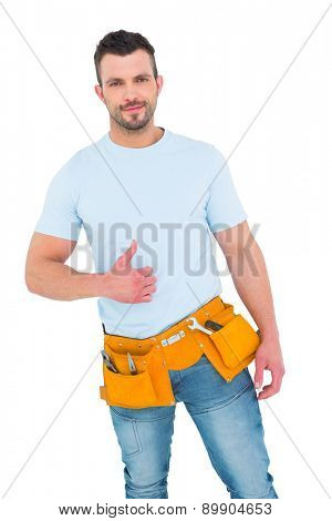 Handyman wearing tool belt with thumbs up on white background