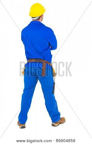 Handyman looking up for something on white background