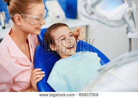 Little girl having mouth checkup