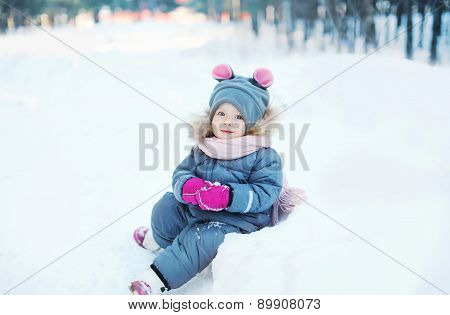 Child Playing On The Snow In Winter Day