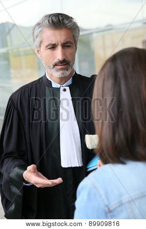 Lawyer meeting client in courthouse before trial