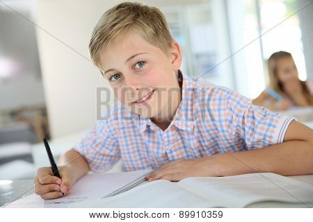 Portrait of 12-year-old boy in classroom