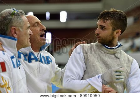ST. PETERSBURG, RUSSIA - MAY 2, 2015: Daniele Garozzo of Italy with coaches after the 1/8 final of International fencing tournament St. Petersburg Foil. The tournament is the stage of FIE World Cup