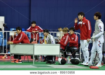 ST. PETERSBURG, RUSSIA - MAY 3, 2015: Korean team during team quarterfinal match against Italy in International fencing tournament St. Petersburg Foil. The tournament is the stage of FIE World Cup