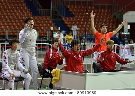 ST. PETERSBURG, RUSSIA - MAY 3, 2015: Korean team reacts during team quarterfinal match against Italy in the International fencing tournament St. Petersburg Foil. The tournament is the stage of FIE World Cup
