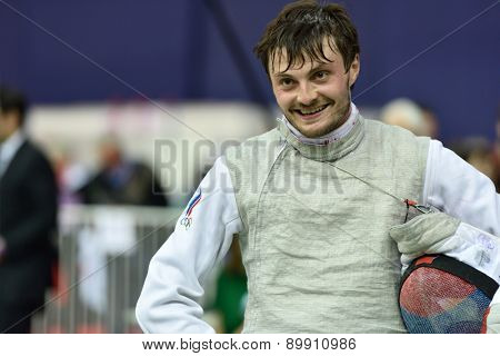 ST. PETERSBURG, RUSSIA - MAY 2, 2015: Dmitry Rigin of Russia smiles after the 1/8 final of 41th International fencing tournament St. Petersburg Foil. The tournament is the stage of FIE World Cup