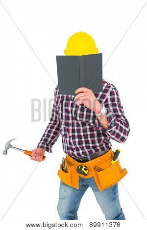 Handyman reading diary and holding hammer on white background