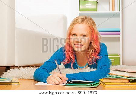 Smart been blond girl do homework on home floor