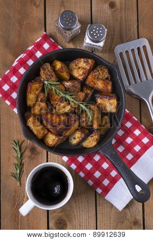 Pan fried potatoes on a breakfast table