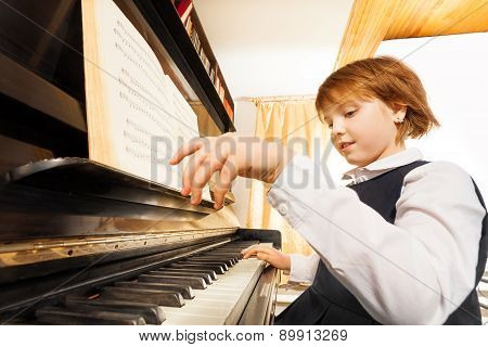 Close-up view of hands playing girl on the piano
