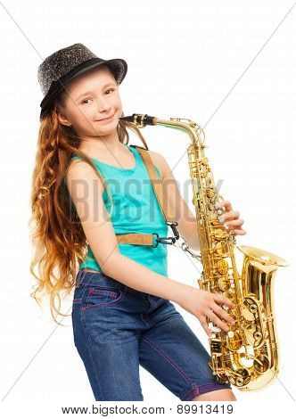 Cute happy girl playing alto saxophone alone