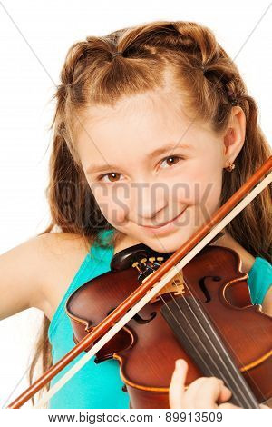 Portrait of beautiful girl playing on violin