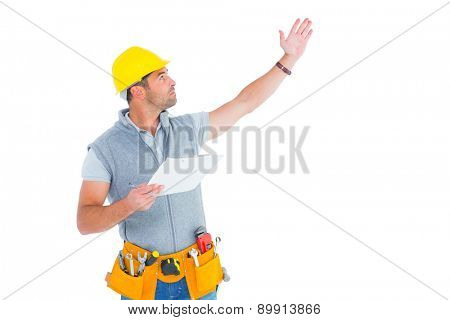 Male supervisor with hand raised holding clipboard on white background