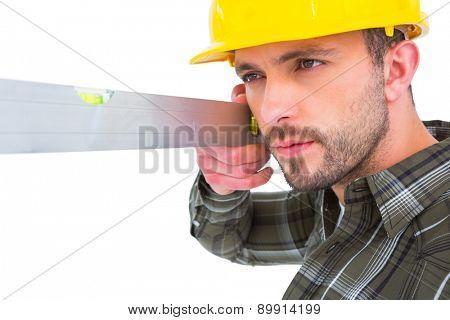 Carpenter using spirit level on white background