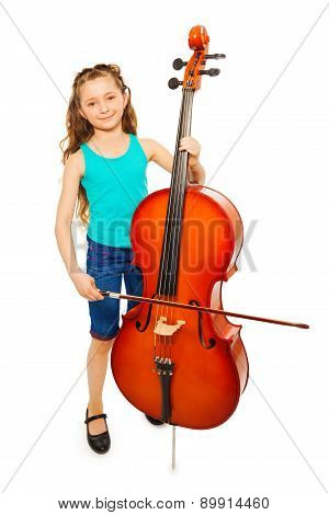 Girl with long hair holds string to play cello