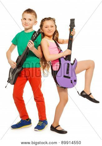 Girl and boy rock playing on electro guitars