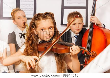 Group of kids playing musical instruments together