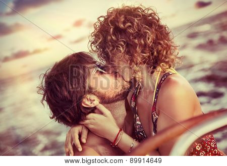 Closeup portrait of cheerful happy lovers kissing on sailboat, young couple having fun in romantic sea traveling, love and enjoyment concept