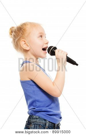 Portrait of small girl singing in microphone