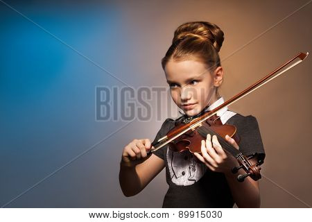 Beautiful girl alone playing on the violin