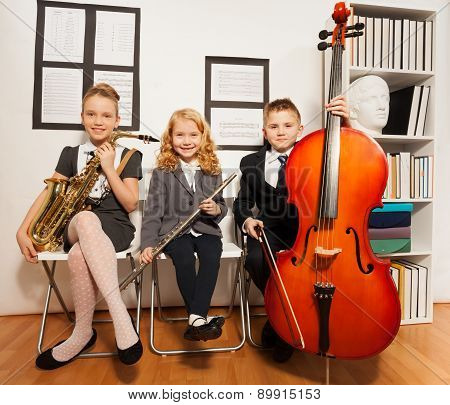 Happy group of kids playing musical instruments